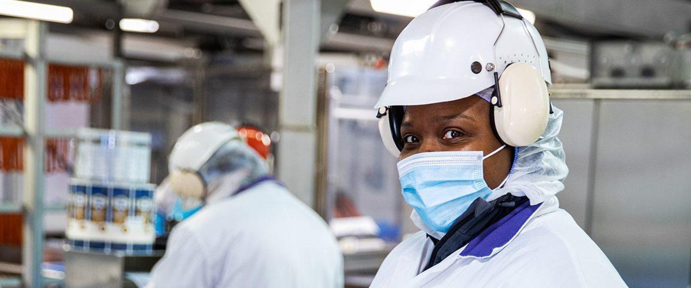 Employee looking at camera in production plant