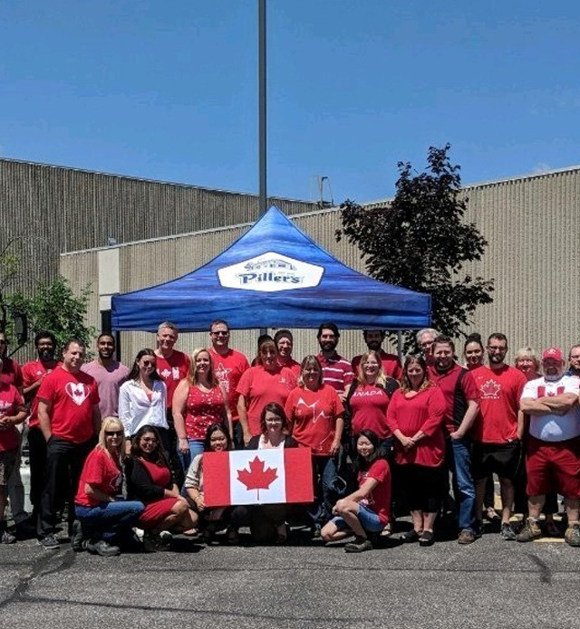 Members of Piller's staff posing outside our plant for Canada day.