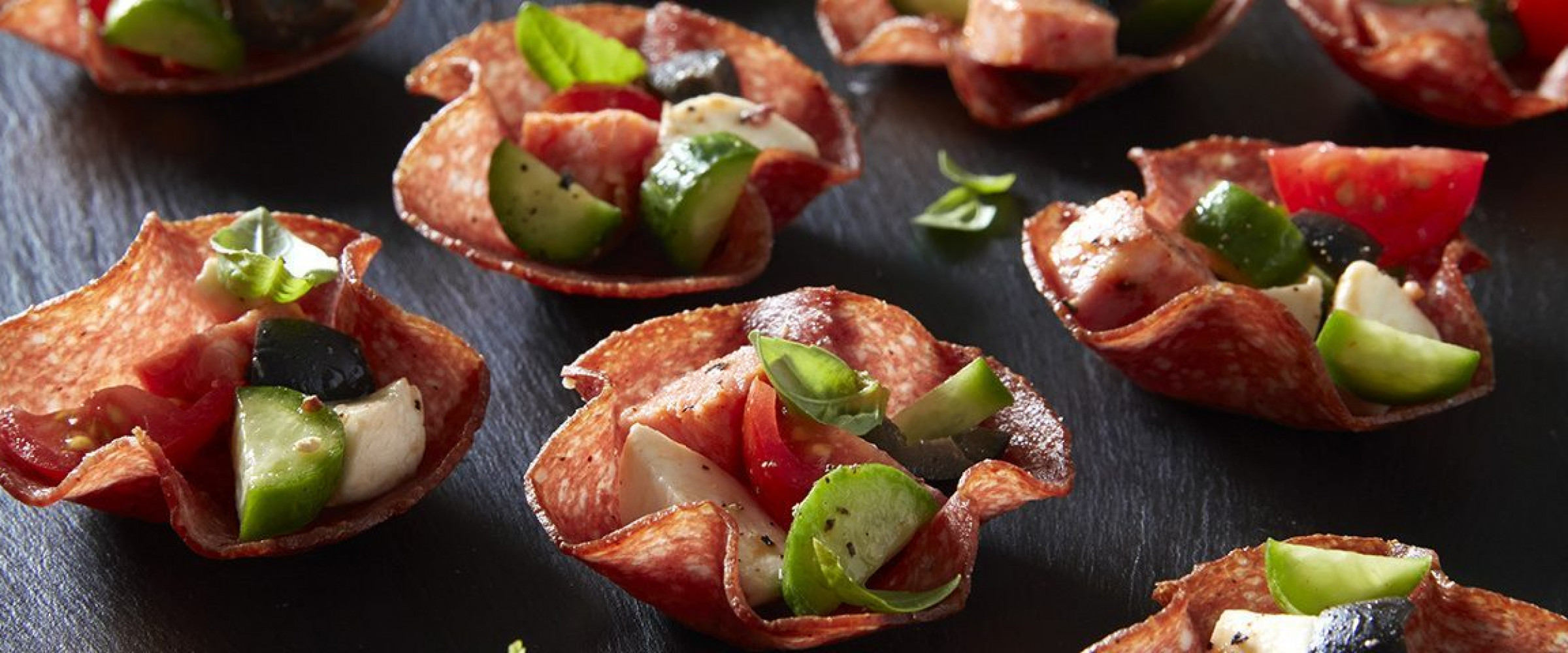 Salami cups with cheese, tomato, and cucumber