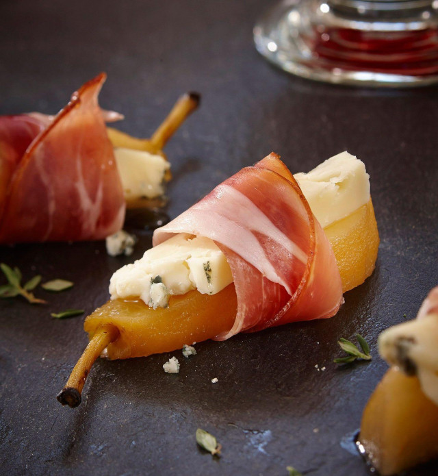 Pear wrapped with speck prosciutto and cheese